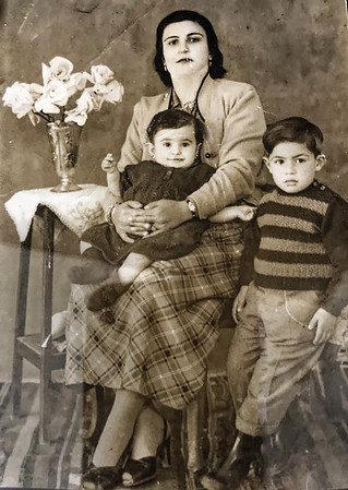 Nadera Abukhalaf in her mother's lap