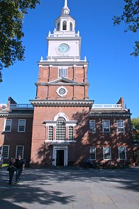 The Bell Tower of Independence Hall in PhiladelphiaAs originally designed and built, Independence Hall had no tower or steeple. These were added around 1750. The wooden steeple had rotted by 1773 and was removed in 1781. In 1828, the city hired architect William Strickland to restore the original steeple. Strickland deviated from the original design, incorporating a clock and additional ornamentation. A recent restoration of the steeple revealed Strickland's modern engineering principles.It consists of a central building with belltower and steeple, attached to two smaller wings via arcaded hyphens. The highest point to the tip of the steeple spire is 168 ft, 7 1⁄4 inches above the ground.