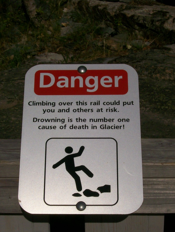 Sign near one of the Glacier National Park waterfalls.