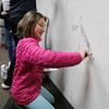 2017 SAAS Middle School Students write their dreams for the new Cardinal Union Building on the Old CUB Walls