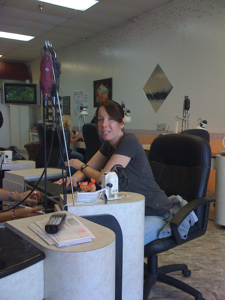 Michele gets her nails done.  Notice the Dremel's hanging everywhere.
