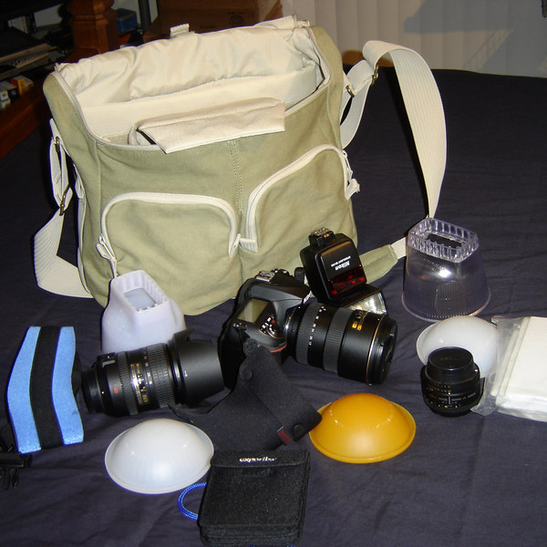 Here you can see most of the gear I'll typically pack for shooting indoors.  All fit very easily in the bag.  Just in case you are wondering that is my D200, a set of Garry Fong clear and cloudy lightsphere's with all the domes I currently have, all my manuals in a sandwich sized zip lock bag, a SB-600 flash, a Tamrac boomerang neck strap, an expodisc, and three lenses: (1) 17-55mm f/2.8 (2) 50mm f/1.8 (3) 18-200 VR lens.  I suppose if I went with a smaller diffuser I could fit in another lens.