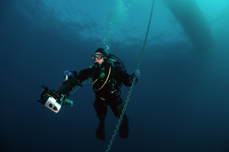 Me on the anchor chain in blue water