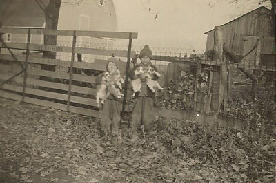 Larry and Bill Schleyhahn Holding Dogs