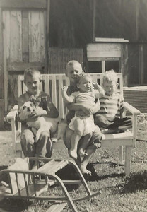 Larry (Holding Dog),; Bill (Holding Dan); and Richard Schleyhahn