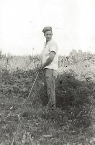 Viney Schleyhahn Raking in Garden