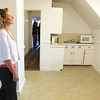 Kristen Kelly Leominster's Planning Director takes a look at one of the kitchen areas at the new Our Father's House Sober House for men in Leominster on Tuesday afternoon during the ribbon cutting ceremony. SENTINEL & ENTERPRISE/JOHN LOVE