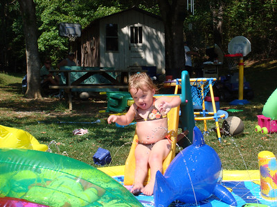 Sydney playing at her Mamaw Ruckers.  We later had to shut down the water slide after we caused the water pump to overheat, leaving the house without water.