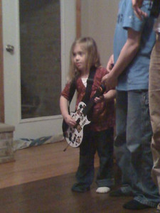 Sydney playing guitar hero.  pic taken with camera phone