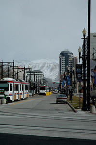 downtown Salt Lake City, where the snow-covered Rocky Mountains are visible from all directions