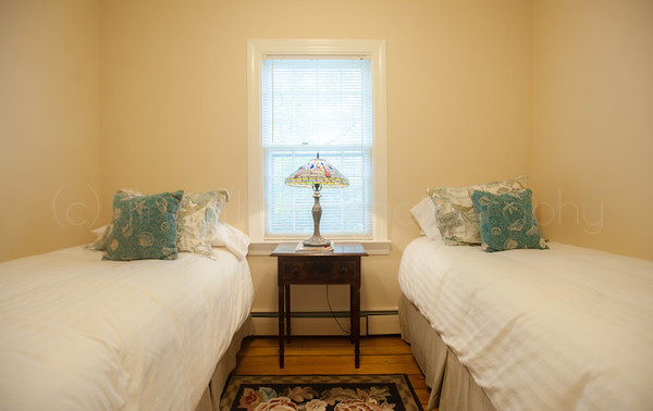 2nd floor bedroom with two twin beds and closet