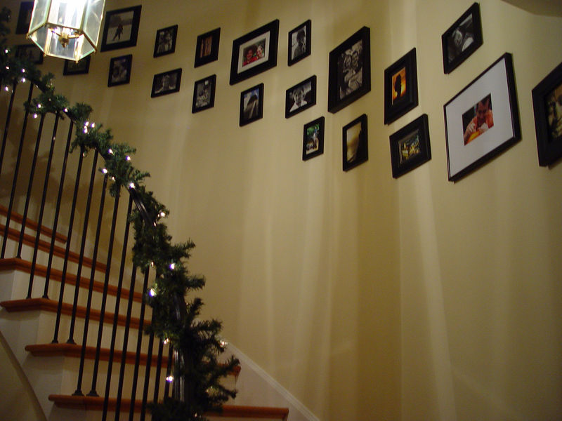 Staircase featuring photos from our travels.
