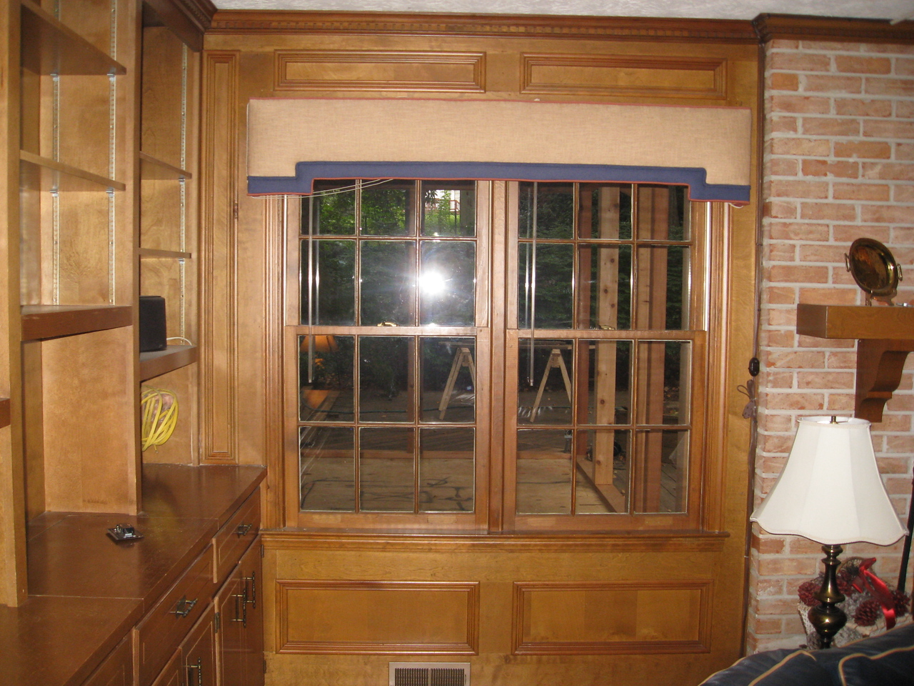 VIEW  FROM INSIDE OF HOUSE OF WINDOW THAT WAS REPLACED WITH SLIDING DOOR.