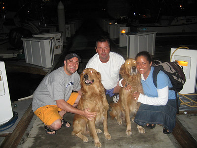 with the owner of the boat and his goldens