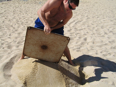 Pete finally got bored of lying in the sun so I told him to make a sandcastle