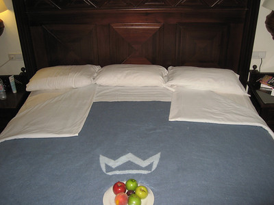 Our bed all turned down with a complimentary fruit plate.