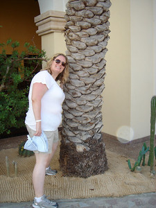 Kate with a palm tree.