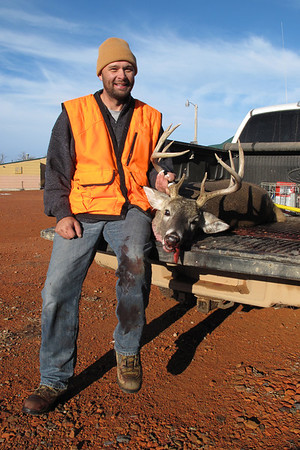 Eric Farstveet with deer taken in shelterbelt north of house Nov. 15, 2010