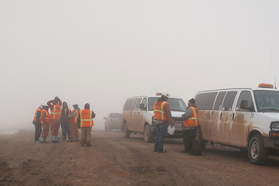 End of shift as the crews gather back at the supply depot near our home. The vans are waiting to take them back to Glendive, Montana, 58 miles to the west.  Heavy snowfall, wind, and fog have made for a perfectly miserable winter by our standards. These guys are from Midland and Brownsville, Texas, and points south. We were constantly amazed at how they were always on the job, despite what the Northern Plains was dishing. I told Rob that they reminded me of our ancestors who settled this country:  tough, adventurous, hard working.  They've made fine neighbors. Because they work everyday, and need to get the workers in and out, they hired plows to keep the roads open. There were several times it would have been impossible to have gotten to the highway, five miles away, had they not opened the roads.