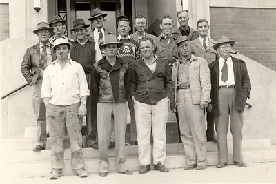"GeoTechnical Corporation Crew  Miles City, Montana Circa 1944-45  My father worked on a seismograph crew. That's him in the front row, far left.  Back then, they would drill a series of ""shot holes"" and put a charge of dynamite down each hole. Then, they'd string a series of receptors attached to a cable on top of the ground and set off the charges. They recorded the vibrations in a recording truck. The resulting information told geologists what type of formations were in the area, helping them determine where to drill for oil or natural gas.   (NOTE: Dad said this was the second time they took the group picture. The first time, he was dressed up like the rest of the crew. For whatever reason, they had to retake it, but he didn't get the memo. He was working on his truck when somebody came and told him he needed to come over for a picture--now! He came as he was.)"