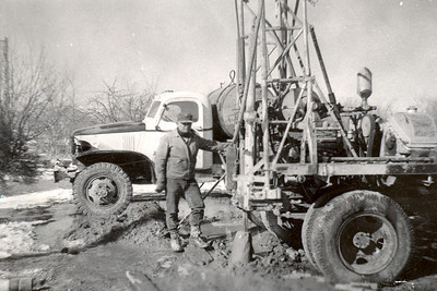 "John Janssen Drilling Water Well  1948  Dad worked for GeoTech for a little more than two years, making 72 cents/hour. They worked in Montana and Wyoming in the summer. When it got cold, they went South. He spent one winter in Oklahoma and one winter in Texas.   When they ran out of work, the crew broke up. Dad came back to Montana and went to work for a drilling company.   Eventually, he got his own rig and started drilling water wells. Dad drilled for a number of years, traveling over quite a bit of eastern Montana. He also did some trucking and got started in farming and ranching.  Of his time spent operating a rig, he commented, ""I done real well in the drilling business; made quite a lot of money. Course, I was a damn fool and wasn't able to keep any of it. I had to spend it all. It came too easy."""