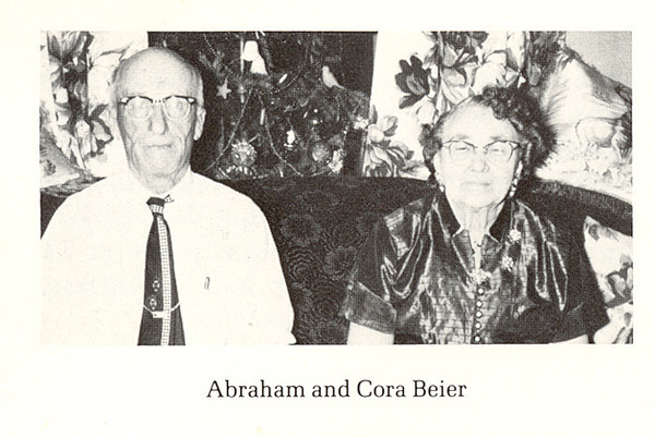 "Abraham ""Abe"" and Cora Beier<br /> <br /> Abraham J. Beier, b. 1879, Parker, S.D.<br /> Came to Golden Valley County around 1900. Homesteaded southeast of Beach on land now owned by Robert Ekre. Died 1958, Glendive Hospital from pneumonia.<br /> Cora Katie Boyer Beier, b, 2 Jan 1883, Ohio; d. 1972, Glendive Hospital from effects of falling and breaking two bones in her leg. She was two weeks shy of her 90th birthday.<br /> <br /> ""In the homestead days the country was full of young bachelors. Jack Crouse, Rube Clark, and Abe Beier were among those bachelor pals who discovered that homesteader Joseph Boyer had some ""red cheeked girls"" and went to call. The first visit was fruitless for the girls modestly remained indoors while their father talked to the men. In 1904 one of the girls, Cora, filed on a homestead and to make her living roomed and boarded teachers and did the laundry for seven men. Mr. Beier was one of those men.""<br /> <br /> ""In 1909 Cora and Abe were married and at first lived in her homestead shack, adding one more room to the two she had. He sold his homestead and purchased in its place the quarter just east of Cora's homestead. The next year they built a fine brick house on the southeastern corner of her quarter. The bricks came from Hebron and Mr. Beier hauled them from Sentinel Butte when the temperature was more than 30 degrees below zero.""<br /> <br /> ""Mr. and Mrs. Beier were very active in the work of the church which originated as a Sunday school started by Mrs. Beier and Mrs. Haugen. The Rocky Butte Church was built on land donated by Mary Tedford and was dedicated in 1910. After the railroad spur was built, the building was moved to Thelen. Both held various offices in the church and Sunday school and were active after the Thelen Church was abandoned and they attended in Beach as long as they as they were able."""