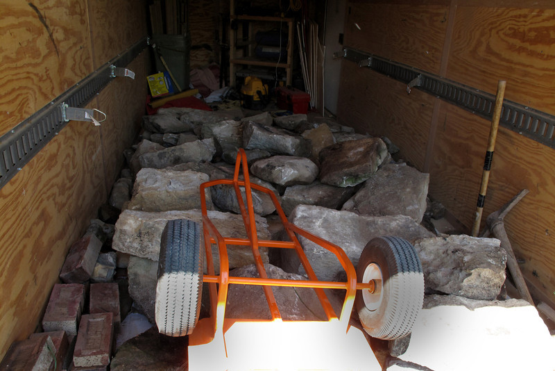 July 24, 2011<br /> We used Rob's cargo trailer today and had quite a nice load of foundation rocks and a few odd bricks. Love the hand cart Brian made for Rob!