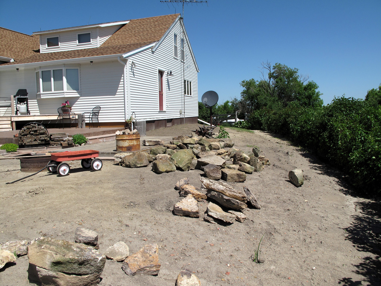 June 29, 2011<br /> First load of rocks unloaded at our home. Let's get this rockin' party started!