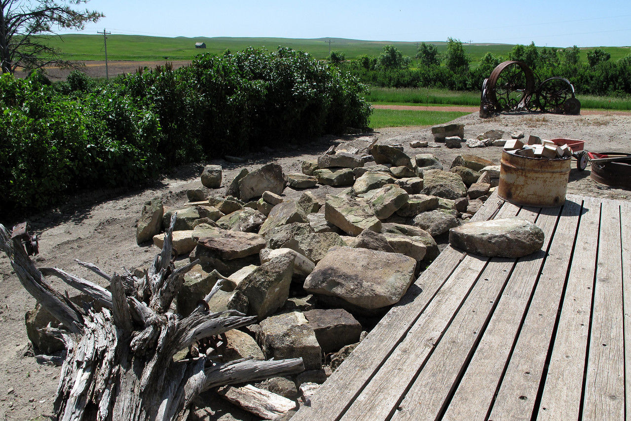 June 28, 2011<br /> First load of rock, looking south. The area where the rocks are to be used is between the metal wheels and the outer edge of the rocks.