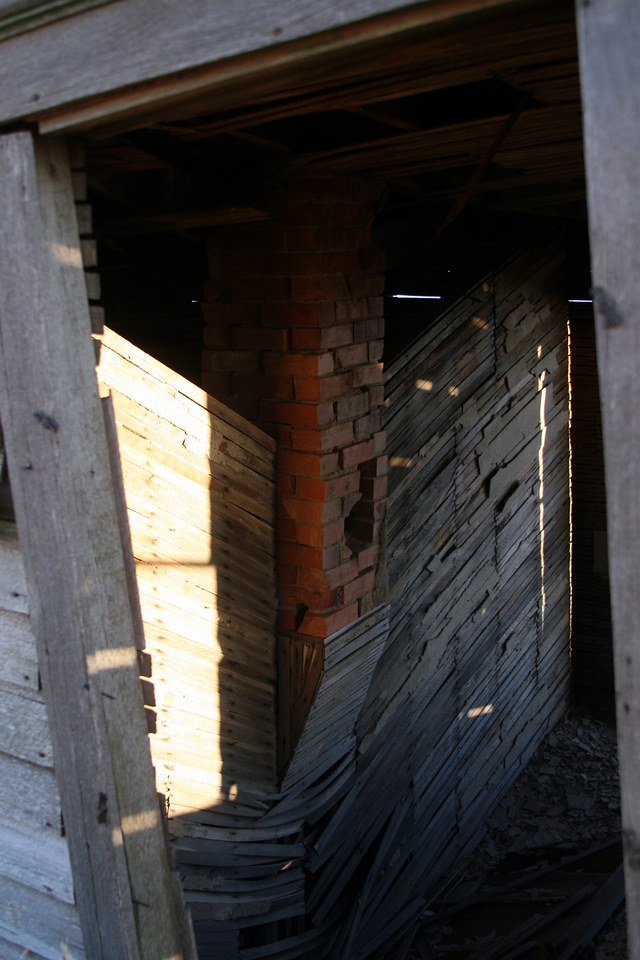 The most you might hope to find in a structure would have been in the chimney. And in this instance, the floor joists have given way, so it's not possible to safely retrieve the bricks.