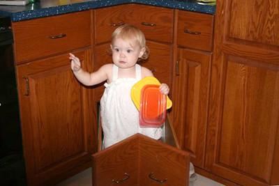 Granddaughter Hadley enjoys Grandma Linda's deep corner drawers.