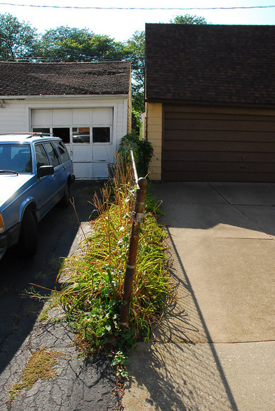 The narrow driveway cannot move to accomodate pushing the garage further from the property line.
