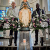 From left, Brother Richard Cote, OMI and Father Wedner Berard, OMI stand with the newly installed statue of Our Lady of the Cape in honor of St. Joseph the Worker Shrine's 60th anniversary. SUN/Caley McGuane