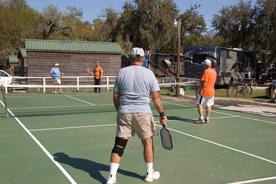Carol, Lou, Buddy and Austin playing pickleball