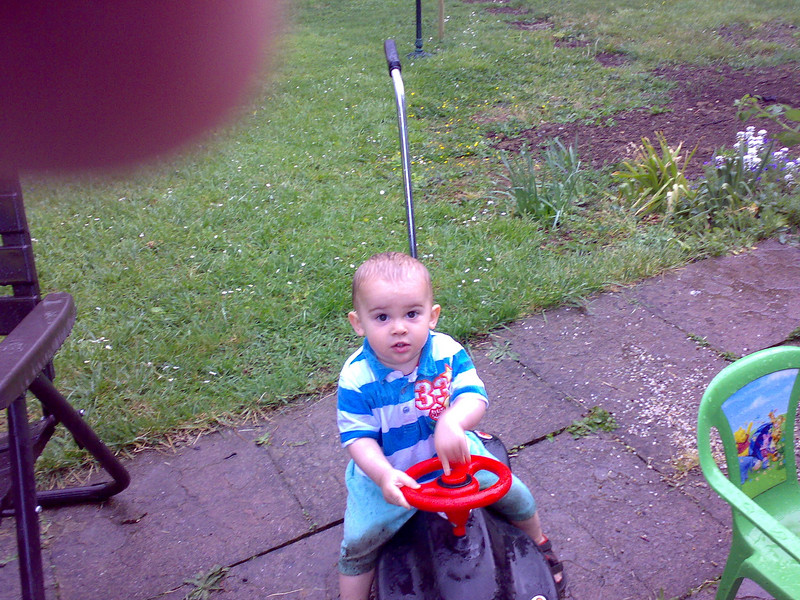Even a downpour won't stop Jack from playing with his beloved Bobby Car