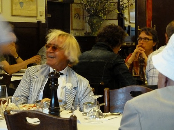 "A guy that looks like Andy Warhol wearing a badge that says ""I'm Not Andy"": only in Basel would you see this!"