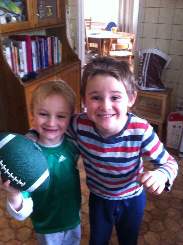 The boys are pleased with their new American football from Andy & Amy