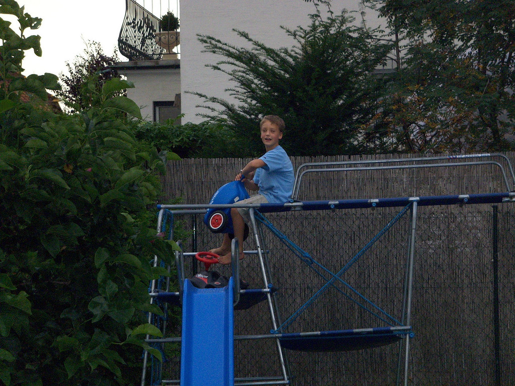 Andrew decided to haul the Bobby Car & trailer to the top of the climbing frame ...