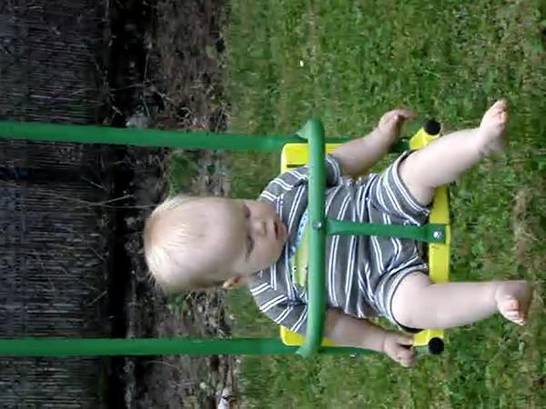 Jakie enjoying the swing in our garden back in June