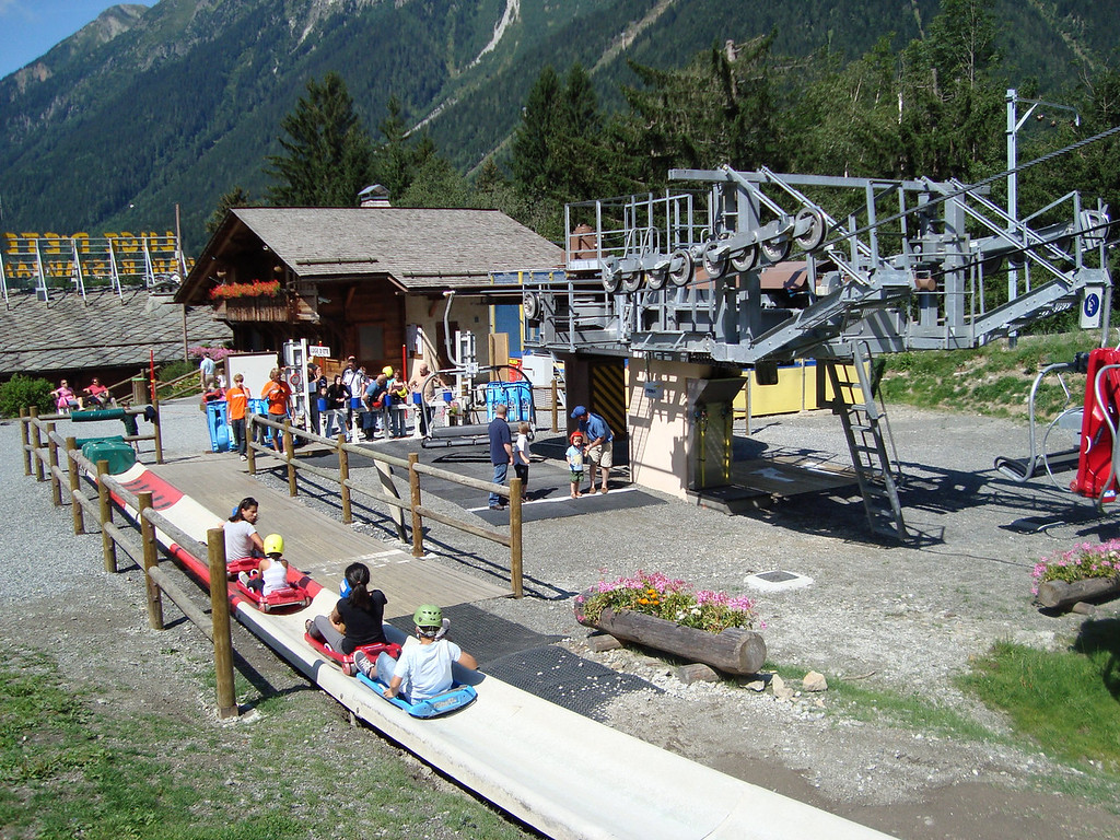 Taking the chairlift up to the adventure course in the trees at the top and the summer toboggan ride down
