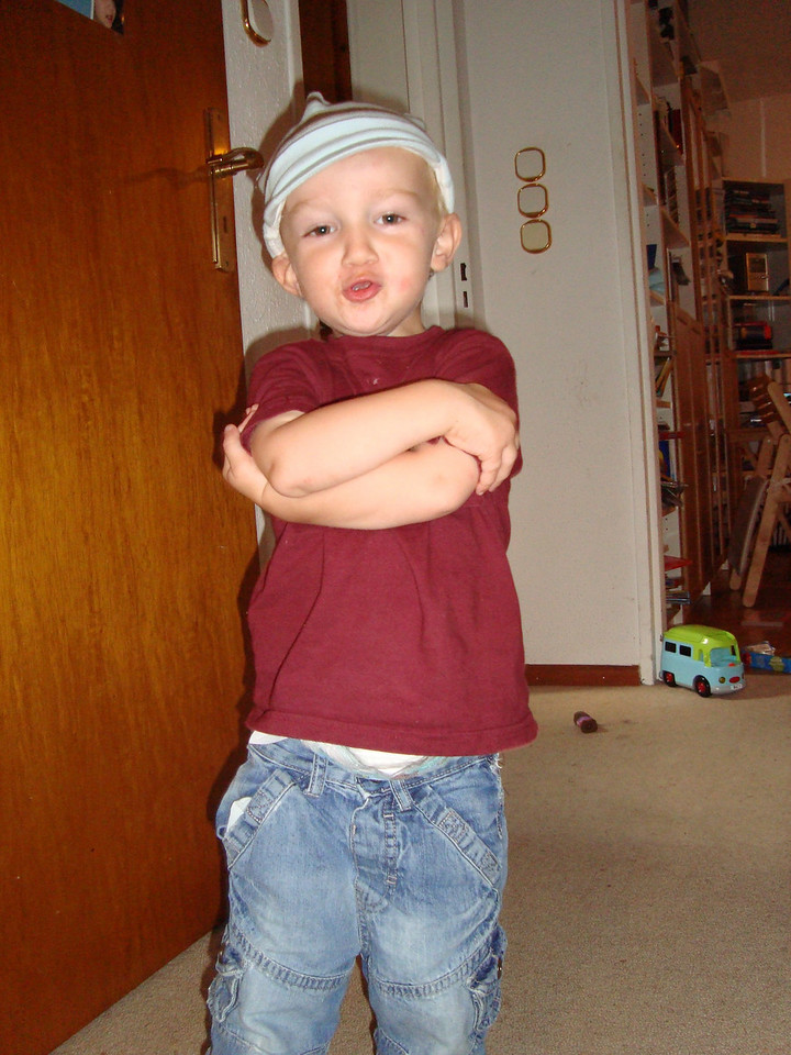 Trying on one of Cullen's many hats he donated to Danny - this one is a little bit gangsta - sup?