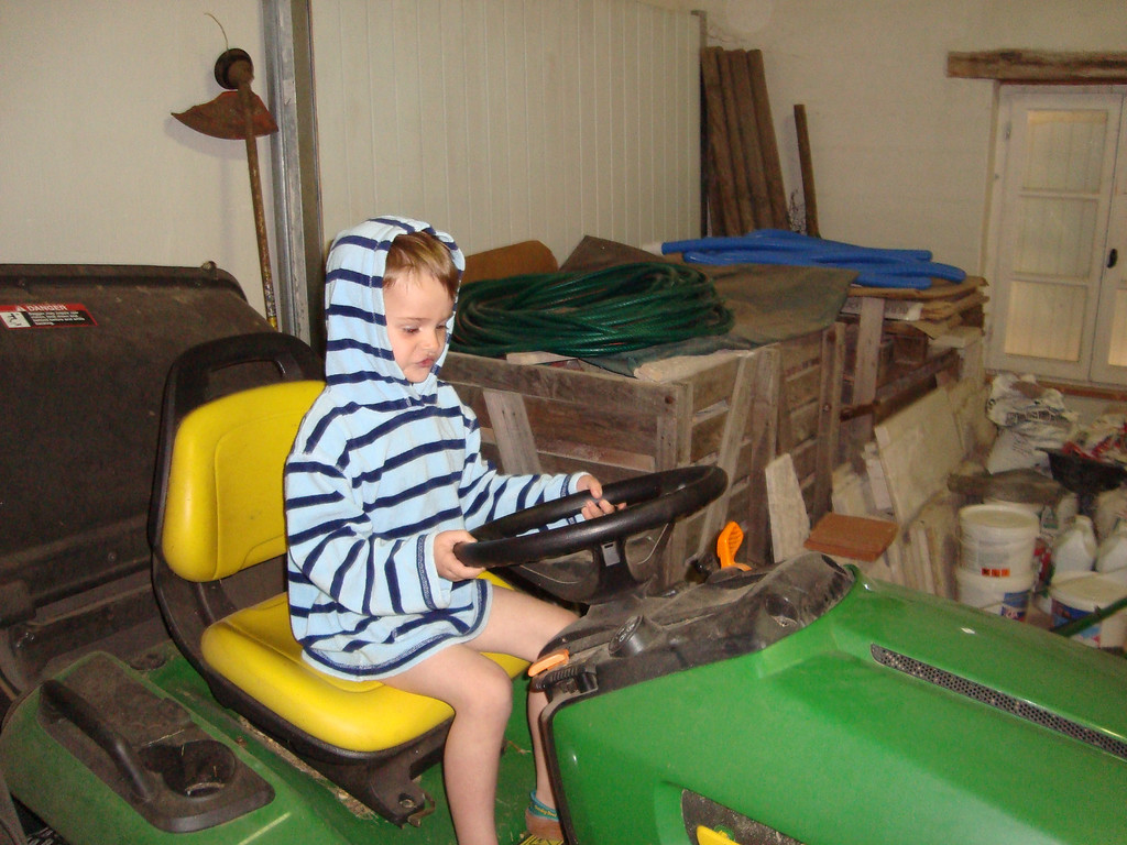 Jack quite often took himself off to the garage to play on the ride-on mowers there