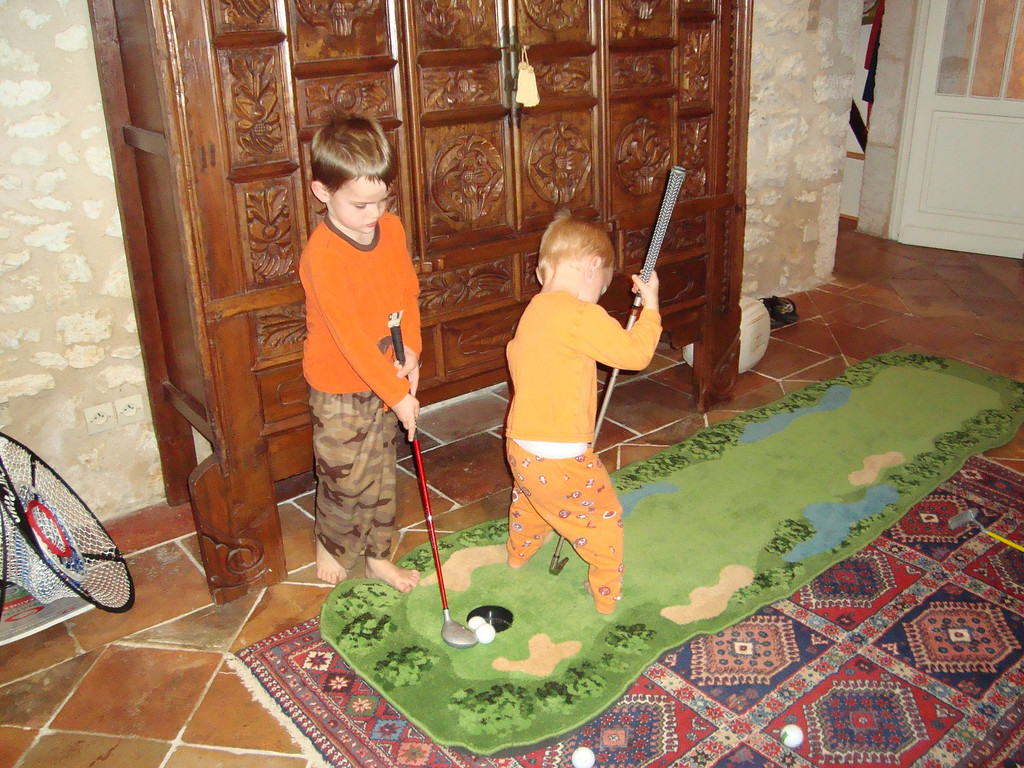 The boys spent a lot of time practicing their putting - Danny's grip may need a little work