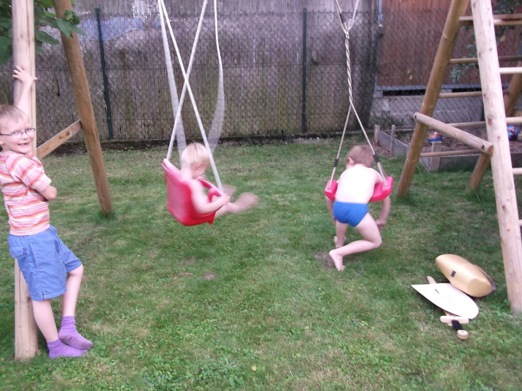 Emilien winding the boys up on the swing-set & letting the unfurl