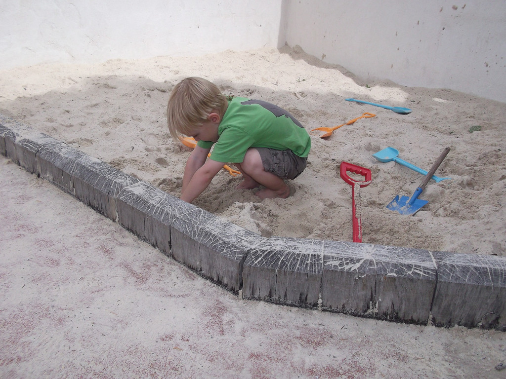 Danny is still happy digging in the sand pit