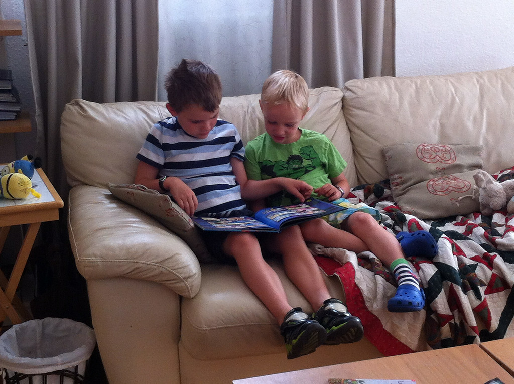 Jack reading to Danny in the morning