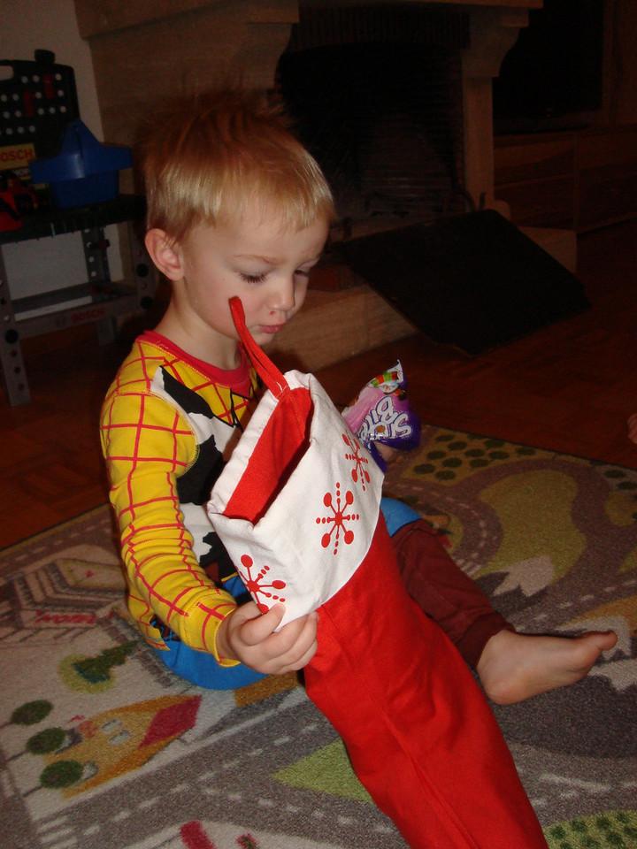 Christmas morning - hooray! Boys still in their Toy Story jamas - start opening the stockings.