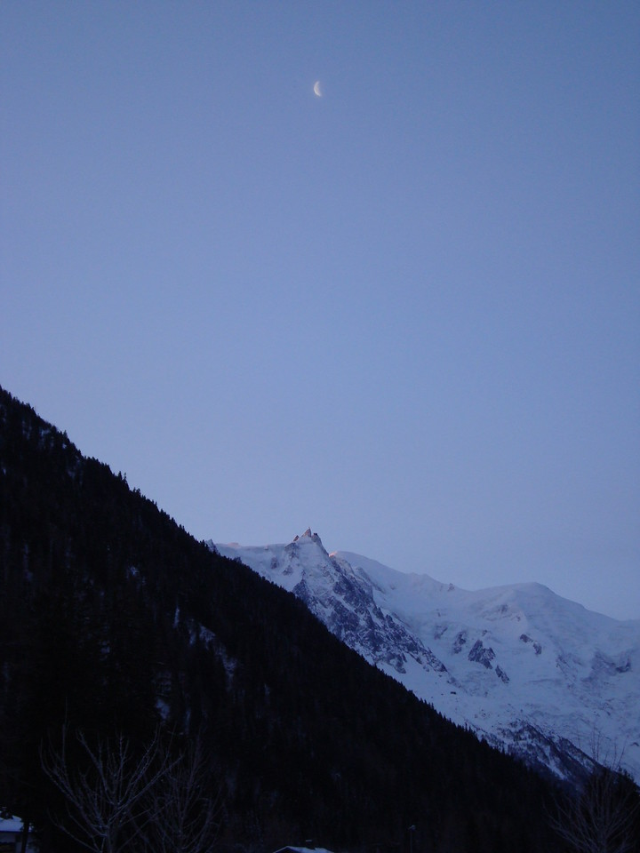 Moon still shining above the mountains; sun starting to hit the opposite side of Mont Blanc