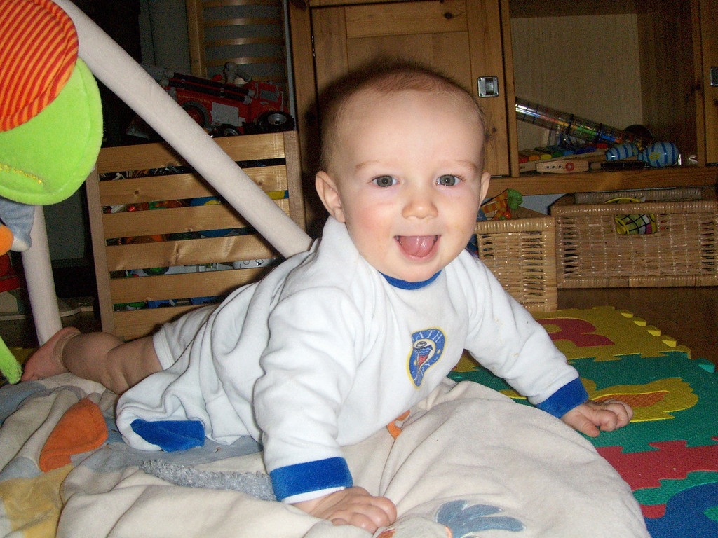 Happy Danny is working his way towards mobility with alarming speed, I think he might be crawling by the end of the year, I've found him up on all fours in crawling position a few times now
