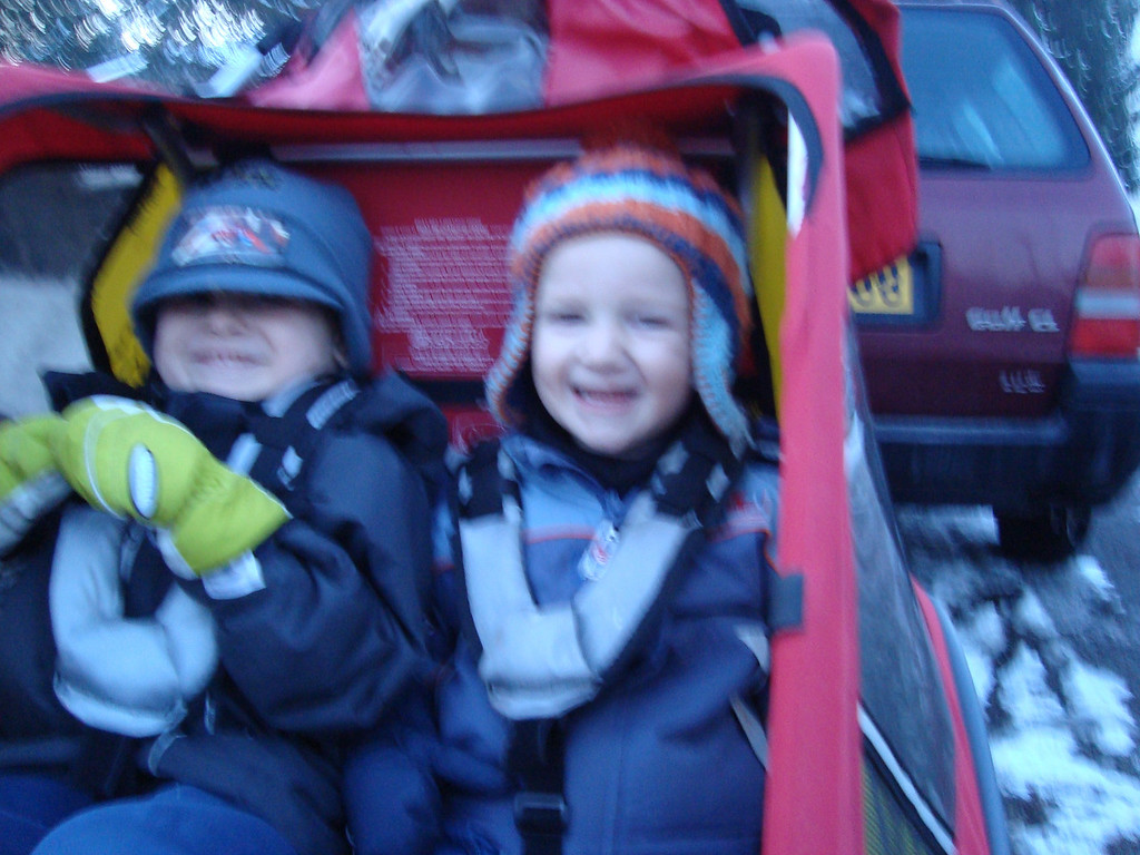 Maybe I need to ask Santa for a new camera for Christmas - some of the best pictures I would have seem to often be blurry :-( This is the boys crammed into the Jackmobile to head into Basel to watch 'Santas on Harleys'